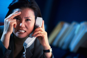 frustrated woman on telephone