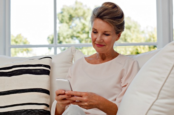 Woman using Facebook on smartphone